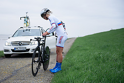 Puncture for Tatiana Anotshina at Omloop van Borsele Time Trial 2016. A 19.9 km individual time trial starting and finishing in 's-Heerenhoek, Netherlands on 22nd April 2016.