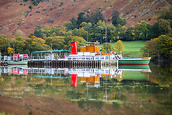 © Licensed to London News Pictures. 15/10/2018. Glenridding UK. One of the Ullswater steamers reflects in to the still water of Ullswater lake near Glenridding this morning in Cumbria. Photo credit: Andrew McCaren/LNP