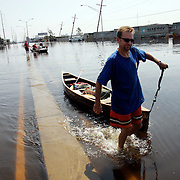 NEW ORLEANS, LA - September 4, 2005:  A man retrieves some his belongings and carries them to dry land on Sept. 4, 2005 in New Orleans, Louisiana. (Photo by Todd Bigelow/Aurora)..