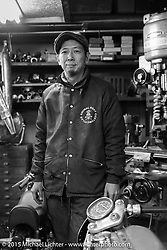 Daisuke Mukasa during a shop visit to his Animal Boat custom motorcycle shop after Mooneyes. Tokyo, Japan. December 8, 2015.  Photography ©2015 Michael Lichter.