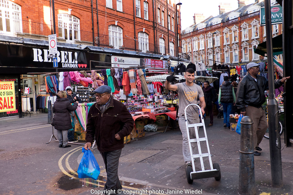 People shopping in Brixton West Indian outdoor market Lambeth South London