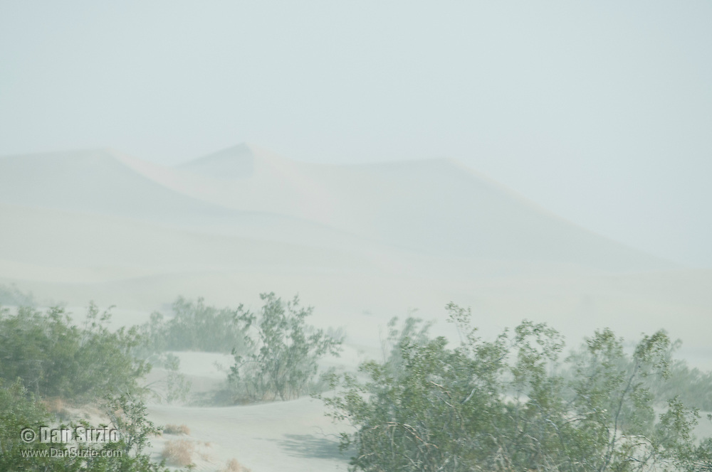 Wind-blown sand obscures the view at the Mesquite Flat Sand Dunes in Death Valley National Park, California
