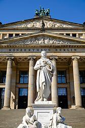 Schiller statue and Kozerthaus in Gendarmenmarkt square in Mitte Berlin Germany