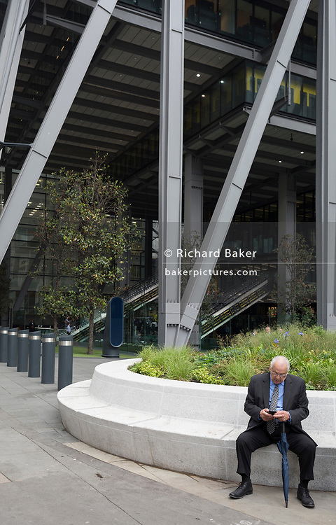 Business people beneath the architecture of the Leadenhall Building on Leadenhall Street, on 30th May 2018, in London, England.