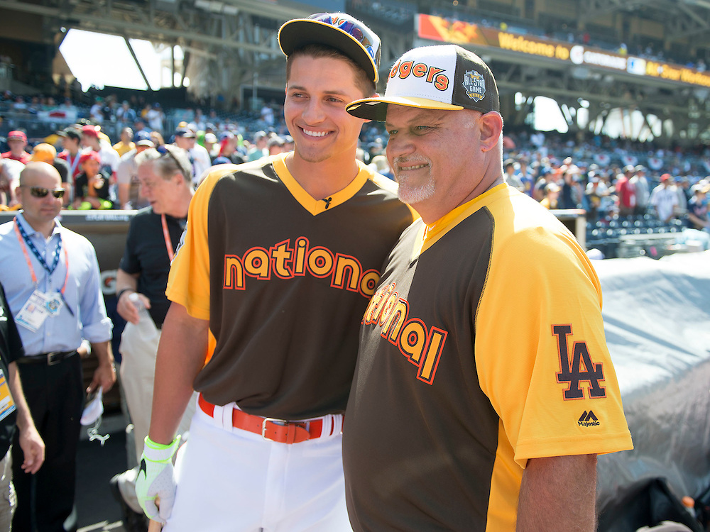 The Dodgers' Corey Seager poses for a photo with his dad Jeff, who threw to him during the 2016 Home Run Derby at Petco Park in San Diego on Monday.<br /> <br /> ///ADDITIONAL INFO:   <br /> <br /> derby.0712.kjs  ---  Photo by KEVIN SULLIVAN / Orange County Register  -- 7/11/16<br /> <br /> The 206 MLB All-Star Game at Petco Park in San Diego. <br /> <br /> Villa Park native and former Angel Mark Trumbo competes in the Home-run Derby.