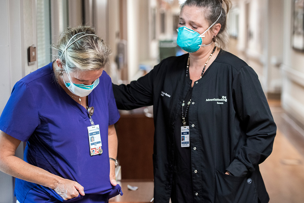 Chaplain Jocelyn Banks (right) comforts R.N. Katie Kelley after they gave end-of-life care to a Covid patient in the Covid ICU at Adventist Health in Sonora, Calif. on Aug. 27, 2021. The hospital had seen 72 hospitalizations due to Covid-19 since Aug. 1, 2021, of which 11 died from complications from the virus.