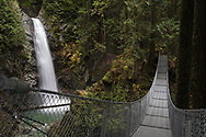 Cascade Falls and the suspension bridge at Cascade Falls Regional Park near Mission, British Columbia, Canada