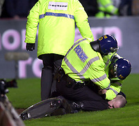 Aston Villa v Birmingham City. Barclaycard Premiership. 03/03/2003<br />Police get to grips with a fan pitch invader.