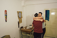 Omar (right) kisses his partner Nader during a game of darts at home in Istanbul. The two Syrians lived together in Turkey for almost a year, until tomorrow when Nader departs for Bergen, Norway, where he has been granted political asylum.