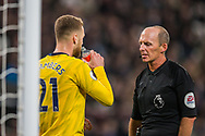 Calum Chambers (Arsenal) talking with Mike Dean (Referee) during the Premier League match between West Ham United and Arsenal at the London Stadium, London, England on 9 December 2019.
