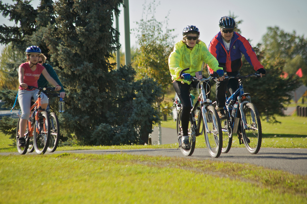Bicycle riders on Anchorage bike trail during One Good Deed for Others 9-11 anniversary event