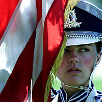 (SPORTS) Manasquan 9/15/2001   Band member Allison Groark 16, a senior at Manasquan H.S holds a flag as the band plays the National Anthem.     Michael  J. Treola STaff Photographer..MJT