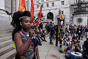 Impassioned speaker at the Walk of Shame disruptive mach through the City of London by environmental group Extinction Rebellion on 4th September 2020 in London, United Kingdom. The walk visited various locations in the financial district, to protest against companies and institutions with historical links to the slave trade, or who finance or insure projects which are seen as ecologically unsound. The message by the group is that 'apologies and token attempts at diversity are not enough to address this legacy and present reality. Our demand is reparations and reparatory justice for those affected by colonial and neo-colonial exploitation'. Extinction Rebellion is a climate change group started in 2018 and has gained a huge following of people committed to peaceful protests. These protests are highlighting that the government is not doing enough to avoid catastrophic climate change and to demand the government take radical action to save the planet.
