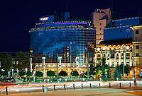 Hyatt hotel in Kyiv, Ukraine. Evening view with street and traffic lights.<br /> Вечерняя фотосъемка отеля Hyatt в Киеве.