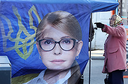 March 28, 2019 - Kiev, Kiev, Ukraine - Ukrainian woman seen next to a campaign tent of Ukrainian presidential candidate Yulia Tymoshenko in down town Kiev, Ukraine..The next Ukrainian presidential elections will take place on 31 March 2019. (Credit Image: © Pavlo Gonchar/SOPA Images via ZUMA Wire)