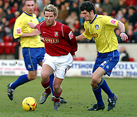 Photo: Dave Linney.<br />Walsall v Colchester United. Coca Cola League 1.<br />14/01/2006.<br />Walsall's Mads Timm (L) heads for goal with Pat Baldwin close by.