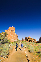 Hikers on the trail to Landscape Arch, Arches National Park, Utah