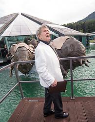 """19.09.2014, Fuschl, AUT, die Bullen von Fuschl, Führung durch das Red Bull Hauptquartier, im Bild Künstler und Bildhauer Jos Pirkner vor seinen Skulpturen """"die Bullen von Fuschl"""" // during the Guided tour of the Red Bull headquarters prior to the opening ceremony of the """"Bullen von Fuschl"""" in Fuschl, Austria on 2014/09/19. EXPA Pictures © 2014, PhotoCredit: EXPA/ Johann Groder"""