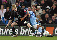 Photo: Paul Thomas.<br />Manchester City v Scunthorpe United. The FA Cup.<br />07/01/2006.<br />Man City's Trevor Sinclair (R) is tackled by Andy Keogh.