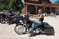 Moonshiner Josh Owens at the Nemo Guest Ranch on the Annual Cycle Source and Michael Lichter Rides (combined this year) left from the new Broken Spoke area of the Iron Horse Saloon during the Sturgis Black Hills Motorcycle Rally. SD, USA.  Wednesday, August 10, 2016.  Photography ©2016 Michael Lichter.