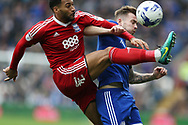 Joe Ralls of Cardiff city ® is challenged by David Davis of Birmingham city. EFL Skybet championship match, Cardiff city v Birmingham City at the Cardiff City Stadium in Cardiff, South Wales on Saturday 11th March 2017.<br /> pic by Andrew Orchard, Andrew Orchard sports photography.