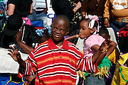 February 28th 2006. New Orleans, Louisiana. United States..Kids wait for the Zulu Mardi Gras Morning Parade on Saint Charles Avenue.