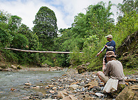 British herpetologist Mark O'Shea (with camera) and American student Jester Ceballos beside the Meleotigi River, near the village of Eraulo in the Ermera District of Timor-Leste (East Timor). The two are part of an ongoing survey of Timorese reptiles and amphibians.