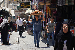 A man carrying traditional bread on his head in the Palestinian quarter of the Old City of Jerusalem. From a series of travel photos taken in Jerusalem and nearby areas. Photo date: Monday, July 30, 2018. Photo credit should read: Richard Gray/EMPICS