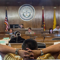 Council delegate Otto Two folds his hands while waiting for quorum for the Naabik'íyáti' special meeting at the Navajo Nation Council chambers in Window Rock Wednesday.