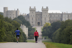 © Licensed to London News Pictures. 01/09/2021. People exercise on a cloudy day on the Long Walk in sight of Windsor castle in Berkshire. Today is the first day of the meteorological autumn. Photo credit: Peter Macdiarmid/LNP