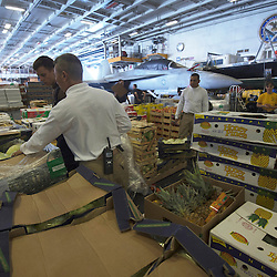 USS John C Stennis CVN-74 Aircraft Carrier.Pic Shows Supplies including fresh fruit in the hangar after RAS or Replenishment at Sea