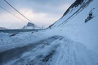 Small snow avalance blocks Myrlandsveien - One of northern Norway's most Avalance and Rockfall prone roads, Flakstadøy, Lofoten Islands, Norway