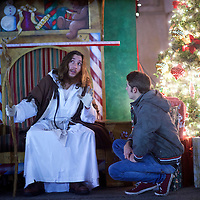 """Michael Hartley, 21, visiting from England, listens to counsel by Michael Grant, 28, """"Philly Jesus,"""" in Philadelphia, PA on December 14, 2014.  Nearly everyday for the last 8 months, Grant has dressed as Jesus Christ, and walked the streets of Philadelphia to share the Christian gospel by example.  He quickly acquired the nickname of """"Philly Jesus,"""" which he has gone by ever since."""