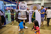 11 MAY 2014 - BANGKOK, THAILAND: A boy checks out the armor of a manga character at Thailand Comic Con at Siam Paragon Mall in Bangkok.    PHOTO BY JACK KURTZ