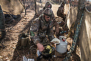 Dave Prather from Bartlesville cooks breakfast burritos on the stove while duck hunting in Shamrock, Oklahoma