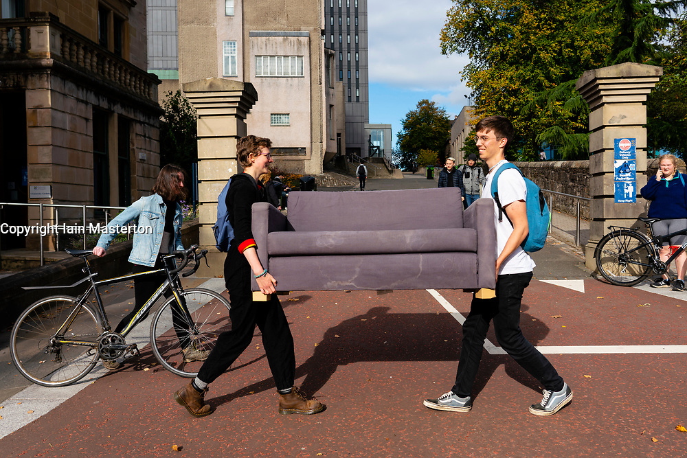 Glasgow, Scotland, UK. 25 September, 2020. Many students at Glasgow University have tested positive for the Covid-19 virus. The Scottish Government has controversially ordered students in several halls of residence where positive cases have spiked, to self-isolate indefinitely. Pictured;  Fresher students transporting a sofa bought on Gumtree. Iain Masterton/Alamy Live News