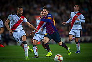 Leo Messi of FC Barcelona fights for the ball with Galvez (left) of Rayo Vallecano during the Spanish league football match of 'La Liga'  FC BARCELONA against RAYO VALLECANO at Camp Nou Stadium of Barcelona on March 9,2019