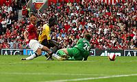 Emmanuel Adebayor Scores winning goal past Man United's Tomasz Kuszczak and Wes Brown<br />Arsenal 2006/07<br />Manchester United V Arsenal (0-1) 17/09/06<br />The Premier League<br />Photo Robin Parker Fotosports International