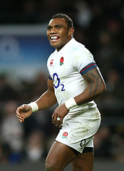 England's Semesa Rokoduguni celebrates scoring his side's fifth try of the game during the Autumn International at Twickenham Stadium, London.