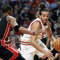 14 March 2012: Chicago Bulls center Joakim Noah (13) drives past Miami Heat power forward Chris Bosh (1) during the first quarter of Chicago Bulls vs the Miami Heat at the United Center, Chicago, Illinois, USA.