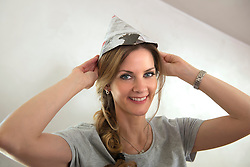 Close-up woman new home wearing paper hat