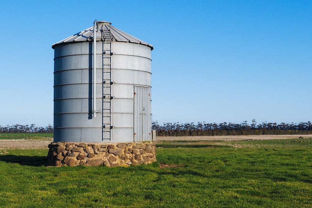 Grain silo in farm paddock in rural country Victoria, Australia. <br /> <br /> Editions:- Open Edition Print / Stock Image