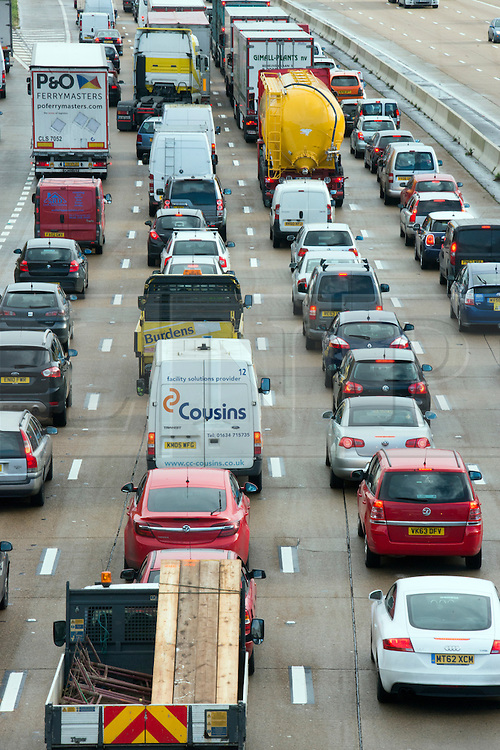 © Licensed to London News Pictures. 14/11/2014. Leatherhead, UK Tailbacks stretched for over twenty miles. M25 section in Surrey collapses following roadworks<br /> M25. The pothole appeared on the M25 in the early hours of 14th November 2014. Three lanes of the M25 in Surrey have been closed after a section collapsed and left a large pothole, following overnight roadworks. Surrey Police said many vehicles had been left with damaged tyres after the road surface near Leatherhead fell in during heavy rain at about 05:30 GMT.. Photo credit : Stephen Simpson/LNP