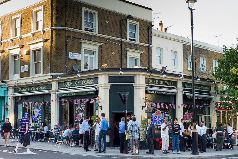 Customers enjoying warm weather at The Duke of York traditional London pub in St John's Wood, London