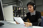 "Radio announcer Li Ming records the program ""Kejia Xiangqing"" in Kejia, or Hakka language in Beijing November 19."