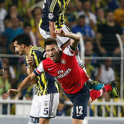 Fenerbahce's Bruno Alves (C) and Arsenal's Olivier Giroud (R) during the UEFA Champions League Play-Offs First leg soccer match Fenerbahce between Arsenal at Sukru Saracaoglu stadium in Istanbul Turkey on Wednesday 21 August 2013. Photo by /TURKPIX