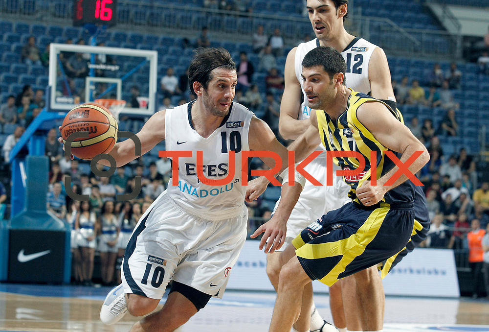 Efes Pilsen's Kerem TUNCERI (L), Kerem GONLUM (B) and Fenerbahce's Omer ONAN (R) during their Turkish Basketball Legague Play-Off semi final second match Efes Pilsen between Fenerbahce at the Sinan Erdem Arena in Istanbul Turkey on Friday 27 May 2011. Photo by TURKPIX