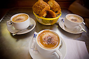 A French breakfast of Cappucino and pain-au-chocolat / croissants.