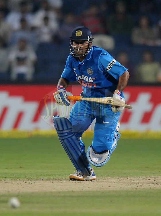 MS Dhoni captain of India bats during the first Airtel T20 Match between India and England held at Subrata Roy Sahara stadium in Pune on the  20th December 2012..Photo by  Pal Pillai/BCCI/SPORTZPICS ..