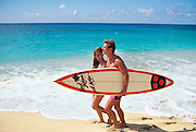 Couple with surfboard, North Shore, Oahu, Hawaii